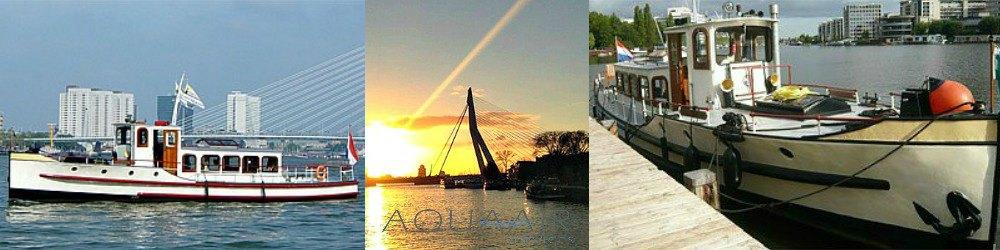 asverstrooiing met ons schip de rotterdam 1 op de maas voor de willemsbrug